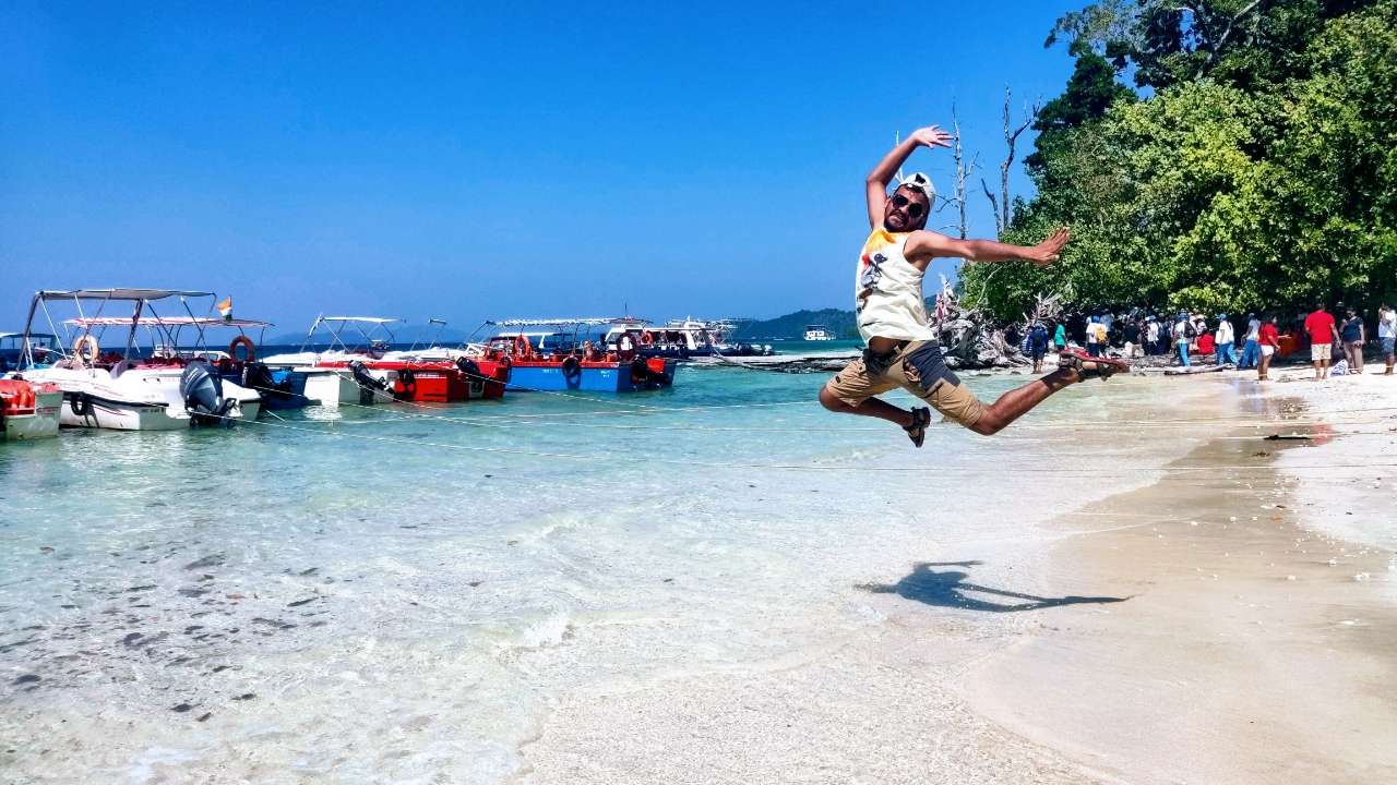 traveler jumping in joy by the sea in Andaman Islands